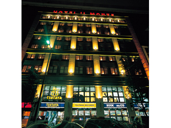 Hotel facade at night.